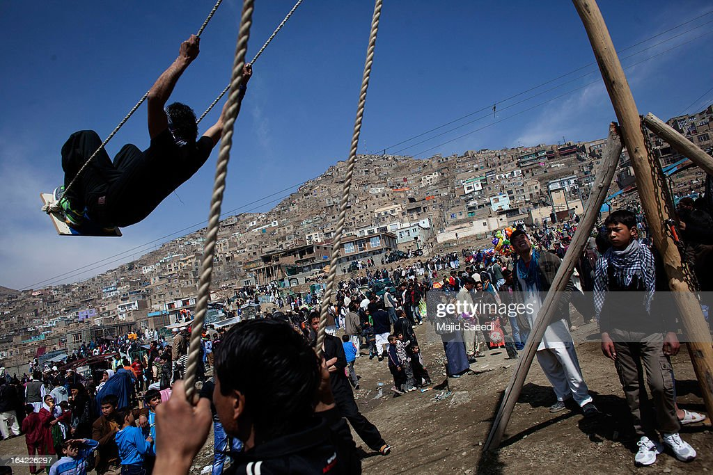 An Afghan boy plays on a swing near the Sakhi shrine, which is the centre of the Afghanistan new year celebrations during the Nowruz festivities on March 21, 2013 in Kabul, Afghanistan. Nowruz is an ancient festival which marks the beginning of the spring equinox and the start of the year in the Iranian calendar, which this coming year will be 1392.
