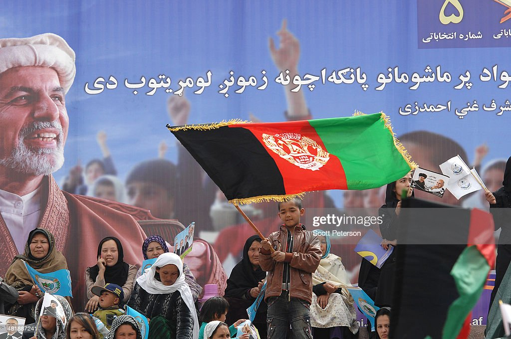 An Afghan boy waves a flag in the women's section as Presidential Candidate Ashraf Ghani Ahmadzai holds a rally for thousands of supporters at the Ghazi stadium on April 1, 2014 in Kabul, Afghanistan. Mr. Ghani is a frontrunner in the April 5 vote to succeed President Hamid Karzai, in an election that is seen as a test of stability that will ensure continued Western donor aid for a nation torn by a Taliban insurgency. The Ghazi stadium is known as the site of amputations and executions during Taliban rule in the late 1990s.