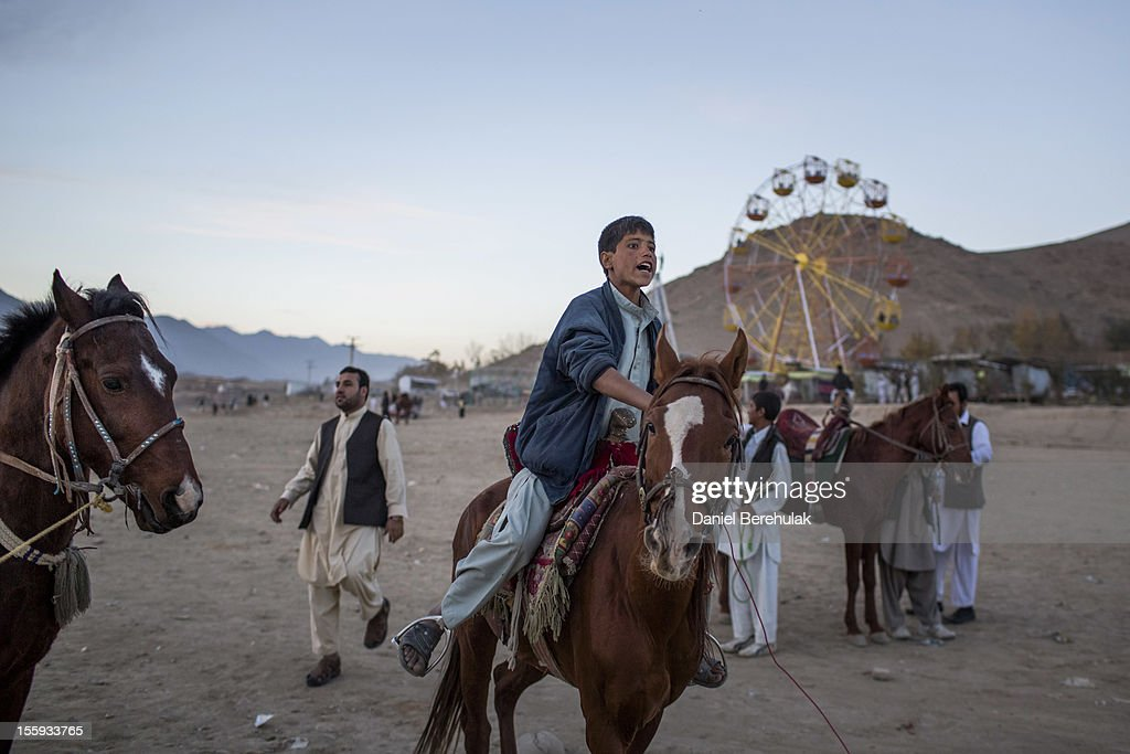 An Afghan boy who is selling horse rides calls to grab the attention of potential customers at the Qargha Lake on November 9, 2012 in Kabul, Afghanistan. The Qargha lake located 9km's out of Kabul, is a popular destination for swimming and boating. The Spojmai Hotel located on the banks of Lake Qargha was attacked by the Taliban in June of 2012.