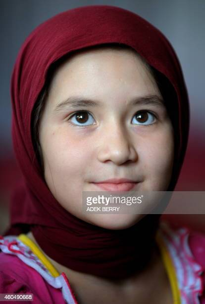 An Afghan child is pictured during a reading Koran class at an Islamic school in Kabul on September 4 2011 Women's rights in Afghanistan risk being...