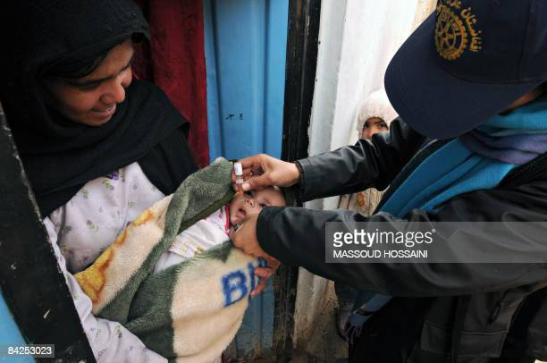 An Afghan child receives a drop of polio vaccine on the second day of a vaccination campaign in Kabul on January 12 2009 A new threeday nationwide...