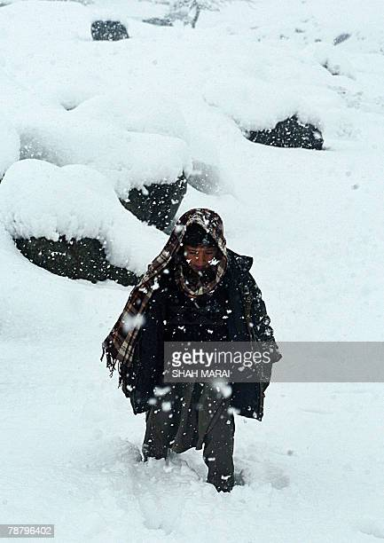 An Afghan child trudges through heavy snowfall on The Shamali Plains some 35 kms north of Kabul 07 January 2008 during the opening ceremony of a new...
