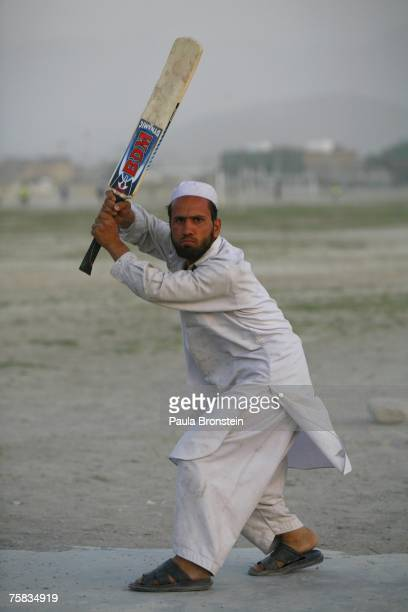 An Afghan cricket player aims his bat during a local league game July 27 2007 in Kabul Afghanistan After the fall of the Taliban when the refugees...