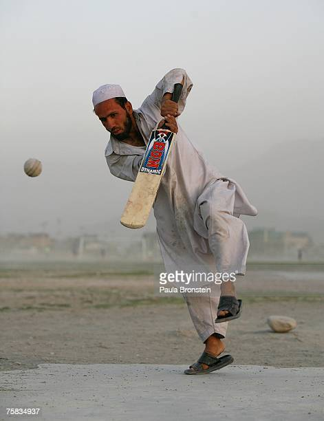 An Afghan cricket player hits the ball during a local league game July 27 2007 Kabul Afghanistan After the fall of the Taliban when the refugees...