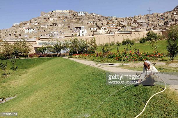 An Afghan gardener waters one of the lawns at Babur's Garden in Kabul on September 23 2008 Babur's Garden on the slope of an arid mountain is in...