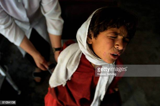 An Afghan Girl Winces As She Receives A Painful Injection To Treat Cutaneous Leishmaniasis Which Is A Disfiguring And Disabling Skin Disease In A...