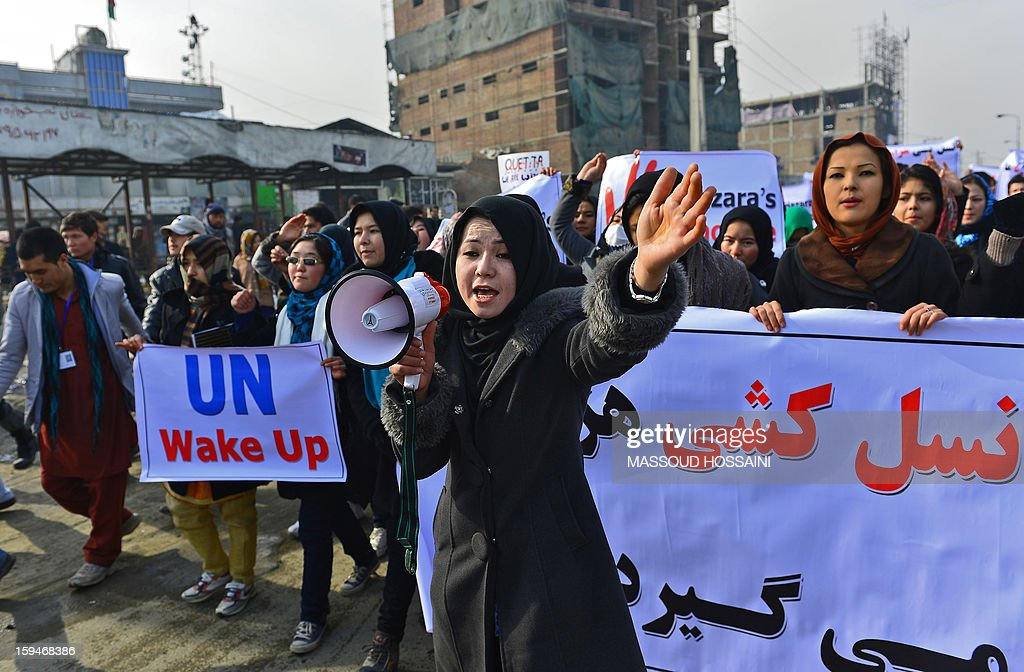 An Afghan Hazara woman (C) shouts slogans to condemn the killing of Hazaras in Quetta city of Pakistan during a demonstration in Kabul on January 14, 2013. Several hundreds of Hazara men and women participated in a demonstration to condemn the twin suicide attacks in Pakistan which killed 92 people in the southwestern city of Quetta on January 10. AFP PHOTO / Massoud HOSSAINI