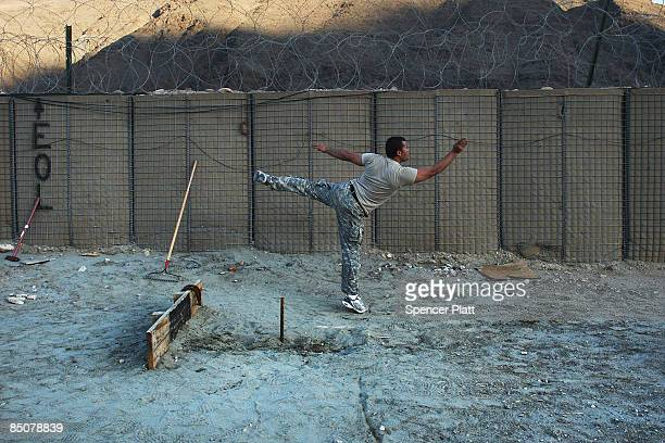 An Afghan interpreter working for the US military plays a game of horseshoes at Forward Operating Base Kalagush February 25 2009 in Nuristan Province...