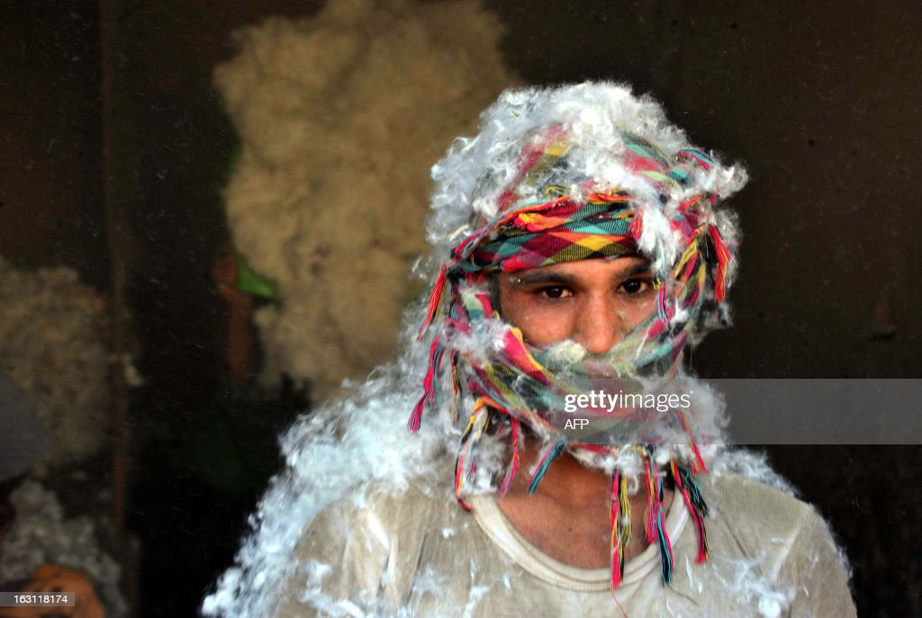 An Afghan labourer pauses in his work at a traditional cotton factory in the city of Jalalabad, capital of Nangarhar province on March 5, 2013. According to figures from the International Cotton Advisory Committee 2012/13, world cotton production is expected to decrease by 6% to 26 million metric tons in 2012/13, while mill use is expected to rise by 3% to 23 million tons. AFP PHOTO / Noorullah Shirzada