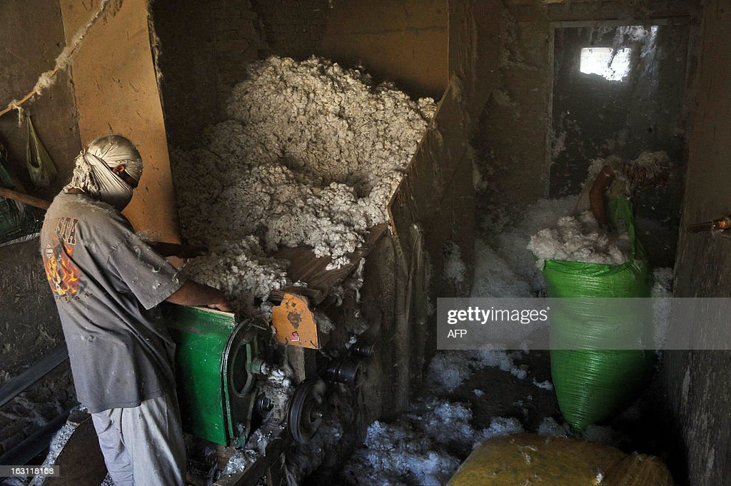 An Afghan labourer works at a traditional cotton factory in the city of Jalalabad, capital of Nangarhar province on March 5, 2013. According to figures from the International Cotton Advisory Committee 2012/13, world cotton production is expected to decrease by 6% to 26 million metric tons in 2012/13, while mill use is expected to rise by 3% to 23 million tons. AFP PHOTO / Noorullah Shirzada