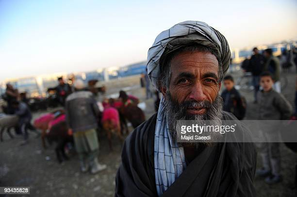 An Afghan man attends the animal market ahead of the Muslim feast of Eid alAdha on November 26 2009 in Kabul Afghanistan The festival of sacrifice is...