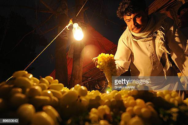 An Afghan man buys fruit in a busy market in Herat on August 6 2009 Afghans go to the polls on August 20 to elect a president for the second time in...