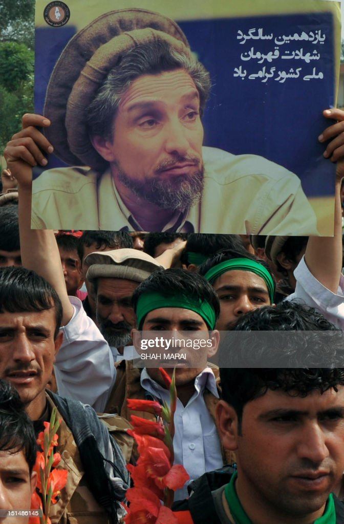 An Afghan man carries a portrait of slain Afghan national hero Ahmad Shah Massoud during a ceremony marking the eleventh anniversary of his death in Kabul on September 8, 2012. Massoud, nicknamed the 'Lion of the Panjshir' for his armed struggle against the Taliban that ruled Afghanistan at the time, died September 9, 2001 when two Tunisians posing as journalists with fake Belgian passports detonated a bomb hidden in the camera as they pretended to interview him. His death, just two days before the September 11 attacks in New York and Washington, has been linked to Osama bin Laden's al-Qaeda network by US officials. AFP PHOTO/ SHAH Marai