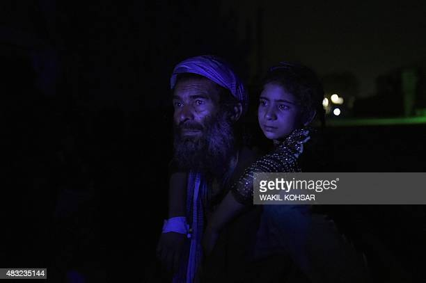 An Afghan man carries his wounded daughter at the site of a powerful truck bomb explosion in Kabul on August 7 2015 A powerful truck bomb killed at...