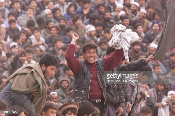 An Afghan man celebrates his side openning goal in a soccer match at the Olympic Stadium in Kabul Afghanistan between ISAF and Kabul FC The game was...