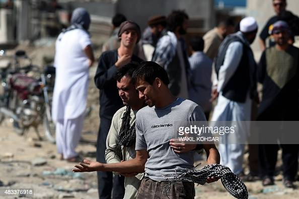 An Afghan man cries as he search for his relatives near Camp Integrity a base housing US special forces that was attacked by militants in Kabul on...