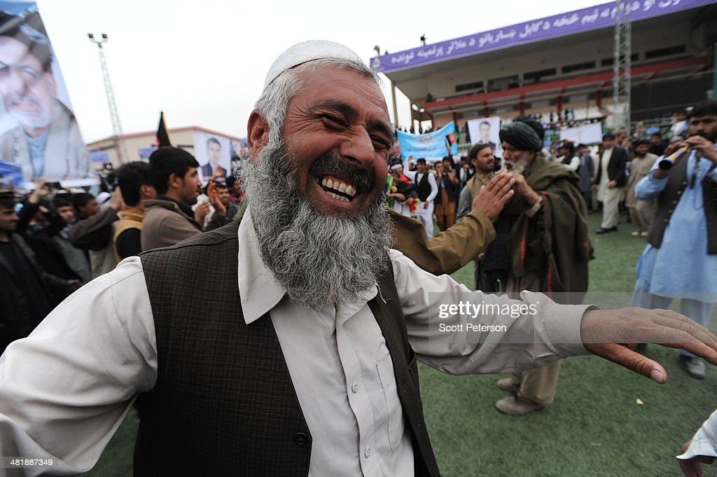 An Afghan man dances as Presidential Candidate Ashraf Ghani Ahmadzai holds a rally for thousands of supporters at the Ghazi stadium on April 1, 2014 in Kabul, Afghanistan. Mr. Ghani is a frontrunner in the April 5 vote to succeed President Hamid Karzai, in an election that is seen as a test of stability that will ensure continued Western donor aid for a nation torn by a Taliban insurgency. The Ghazi stadium is known as the site of amputations and executions during Taliban rule in the late 1990s.