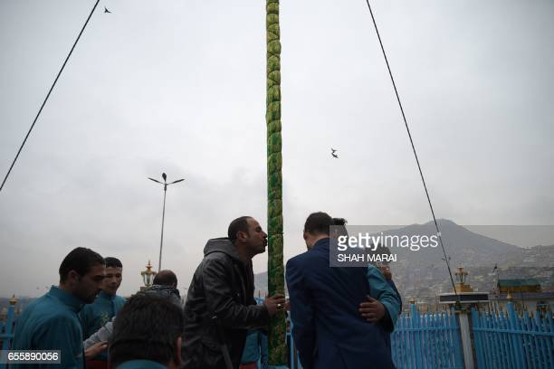 An Afghan man kisses the holy mace in front of the Sakhi shrine during Nowruz festivities which mark the Afghan New Year in Kabul on March 21 2017...