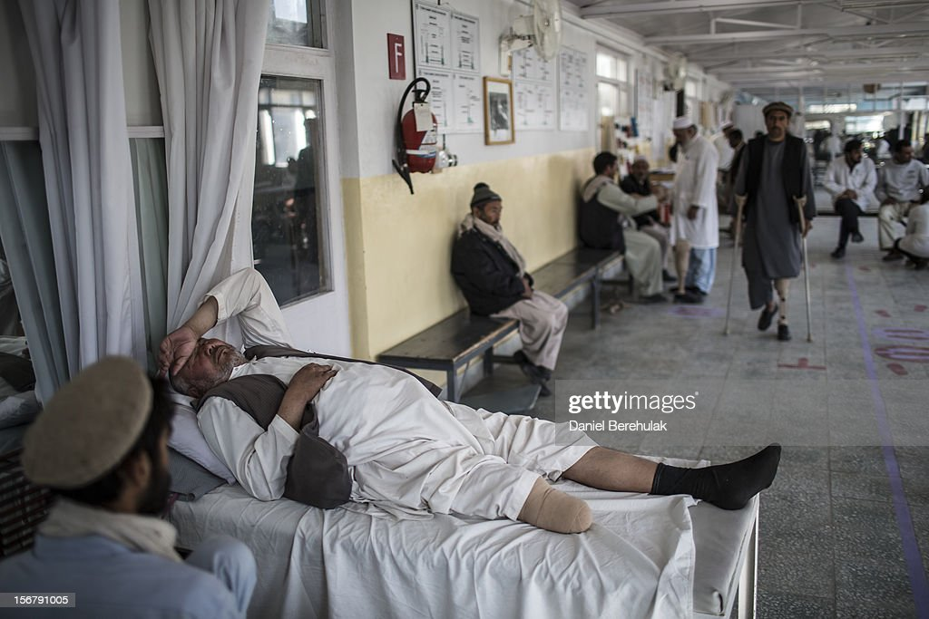 An Afghan man lays in bed as he waits for his prosthetic leg to be fitted by a specialist at the International Committee of the Red Cross (ICRC), orthopedic centre on November 20, 2012 in Kabul, Afghanistan. The ICRC rehabilitation centre works to educate and rehabilitate land-mine victims, and those with limb related deformities, back into society and employment offering micro-credit financing, home schooling and vocational training to patients. The clinic itself is unique in that all of the workers are handicapped. The ICRC centre in Kabul has registered over 57,000 patients and 114,000 countrywide in all of their centres since its inception 25 years ago.