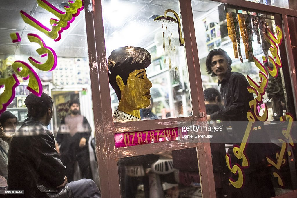 An Afghan man looks from a barbers shop in the Old City on November 12, 2012 in Kabul, Afghanistan.