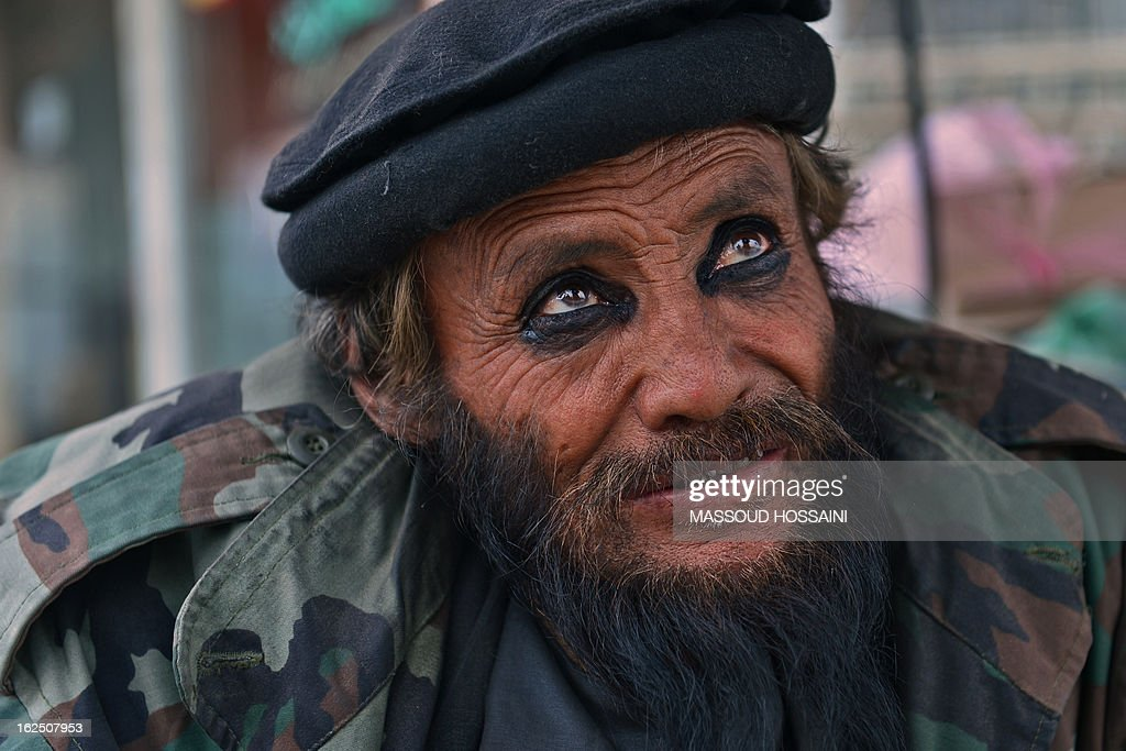 An Afghan man, pictured wearing traditional eyeliner, looks on at a street in Kabul on February 24, 2013. The war-torn country, beset by a decade-long Taliban insurgency and rampant corruption, is one of the world's poorest economies, with more than a third of the population living below the poverty line in 2008. AFP PHOTO/Massoud HOSSAINI