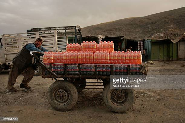 An Afghan man pushes his goods in a street in the old city of Kabul 17 May 2007 Two bombs tore through the centre of Afghanistan's southern city of...