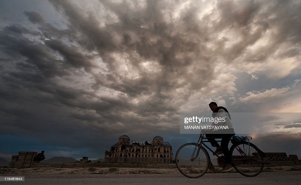 An Afghan man rides a bicycle past the ruins of Darul Aman palace, the former house of Afghan King Amanullah (1920-1929), in Kabul on May 7, 2011. The Taliban unleashed a wave of attacks including six suicide bombings on government targets in the major southern Afghan city of Kandahar Saturday, leaving at least 30 people wounded.