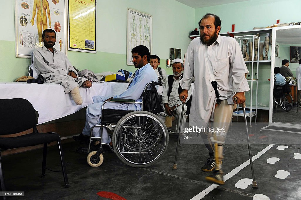 An Afghan man who lost his left leg on a land mine walks at an International Committee of the Red Cross (ICRC) hospital for war victims and the disabled in Herat on June 9, 2013. The ICRC maintains strict impartiality in the Afghan war, and the two-hour assault on its compound in Jalalabad on May 29 provoked widespread shock as well as fears that aid groups could withdraw from the country. AFP PHOTO/Aref KARIMI