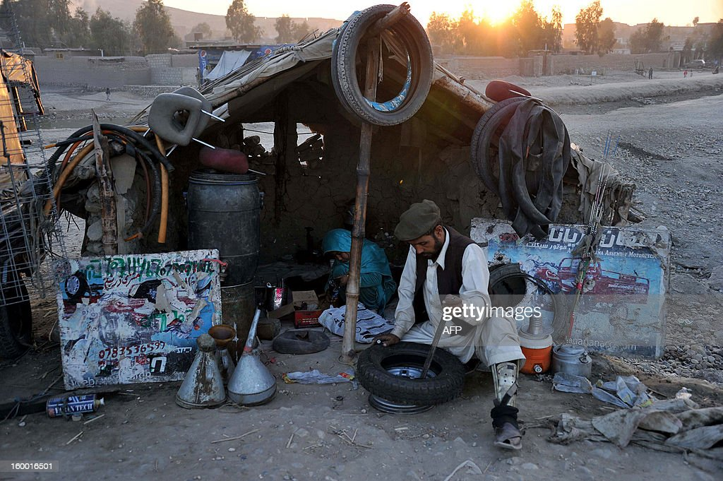 An Afghan mechanic works in his workshop on the outskirts of Jalalabad on January 24, 2013. Over a third of Afghans are living in abject poverty, as those in power are more concerned about addressing their vested interests rather than the basic needs of the population, a UN report said. AFP PHOTO/Noorullah Shirzada