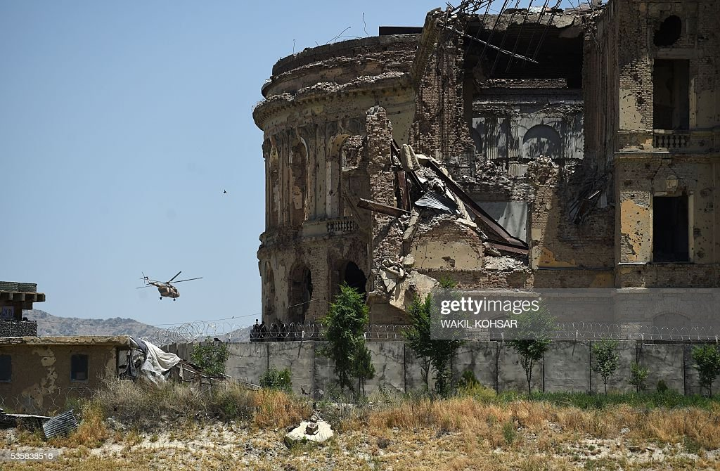 An Afghan military helicopter flies near the ruined Darul Aman Palace in Kabul on May 30, 2016. Afghan President Ashraf Ghani has launched restoration work at Kabul's historic Darul Aman Palace, whose bombed out ruins have long symbolised the suffering caused by the country's decades-long conflict. The once-grand hilltop palace at the edge of Kabul was also the venue of Ghani's cabinet meeting on May 30, the first such official gathering there in nearly a century. KOHSAR