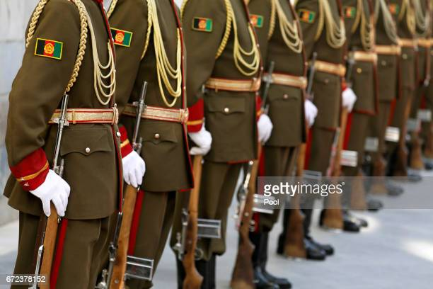 An Afghan military honor guard waits to greet US Defense Secretary James Mattis upon his arrival to meet Afghanistan's President Ashraf Ghani at the...