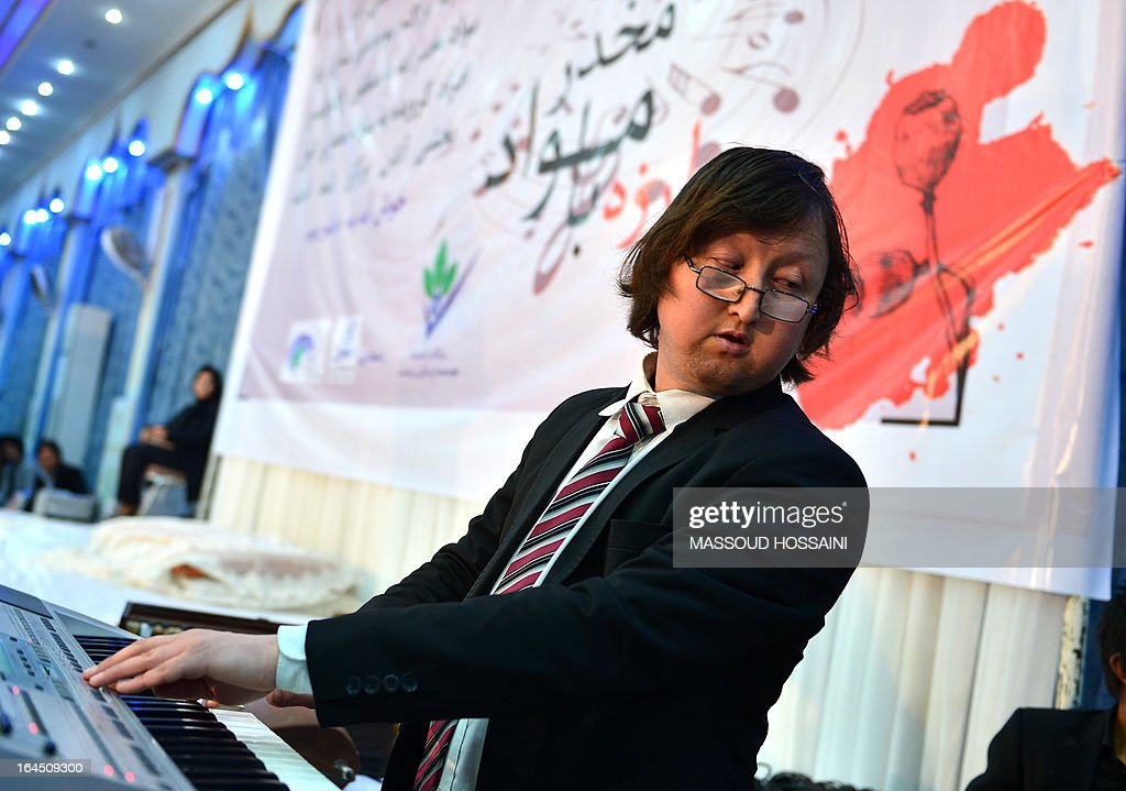An Afghan musician plays on an electronic key-board during a concert to highlight the Fight against Addiction, arranged by the 'Life Is Beautiful' organisation who work on the rehabilitation of drug addicts, in Kabul on March 24, 2013. According to new reports from the United Nations, there are approximately 272 million drug addicts world-wide with 10 million in the region and one million in Afghanistan, the minister of public health Suraya Dalil said.