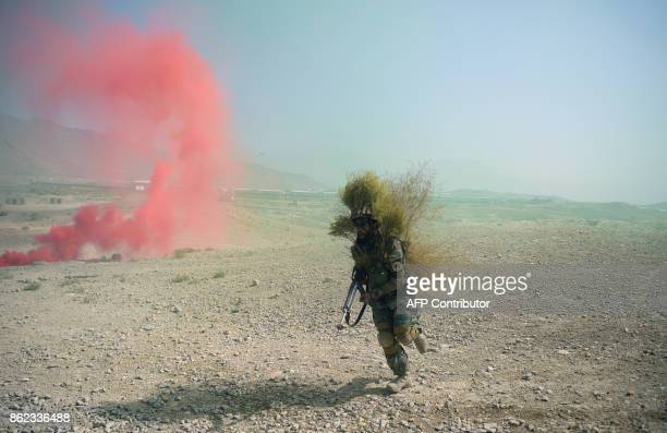 An Afghan National Army commando takes part in a military exercise at the Kabul Military Training Centre on the outskirts of Kabul on October 17 2017...