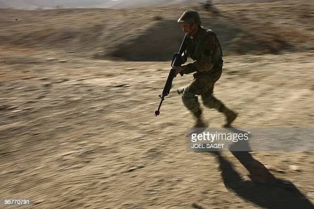 An Afghan National Army officer trains with the French army within the framework of the Epidote programme at the Kabul Military Training Camp near...