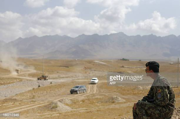 An Afghan National Army official looks on as he takes notes at Camp PoleCharki during training exercises and tactical manoeuvres operated by French...