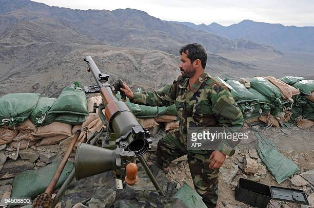 An Afghan National Army soldier cleans an SPG9 recoiless rifle on top of a mountain at Afghan combat outpost Tango in Sarkani district in Kunar...