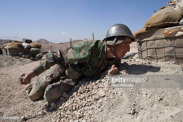 An Afghan National Army soldier gets ready to throw a grenade during combat training at the Kabul Military Training Center October 2 2010 in Kabul...