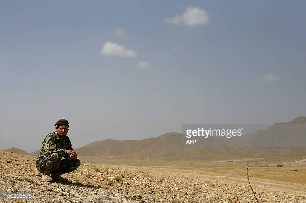 An Afghan National Army soldier looks on during training exercises and tactical manoeuvres operated by French Army's mentors members of the 'Epidote'...