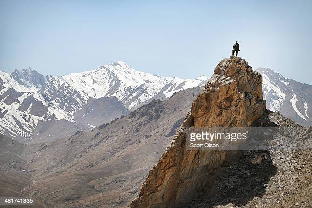An Afghan National Army soldier looks out from a rocky overlook as soldiers with the US Army's 2nd Battalion 87th Infantry Regiment 3rd Brigade...