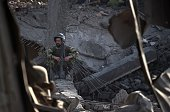 An Afghan National Army soldier sits inside a damaged building after a powerful truck bomb explosion in Kabul on August 7 2015 A powerful truck bomb...