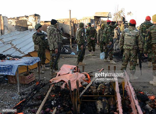 An Afghan National Army soldiers gather after clashes against security forces at Kandahar Airport on December 9 a sprawling complex which also houses...