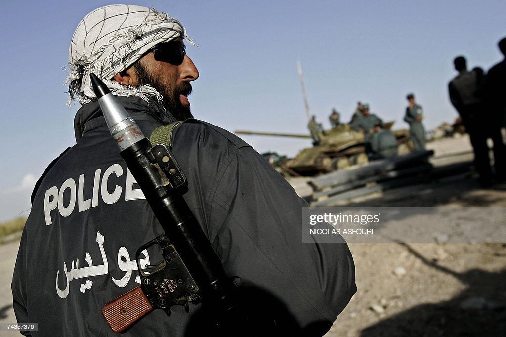 An Afghan National Police officer carries a Bazooka at an undisclosed location in the Ghazni province of Afghanistan some 200 km south west of Kabul...