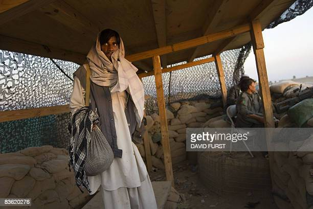 An Afghan National Policeman pauses at an observation post in the hills of the Sabari district of Khost Province along the AfghanPakistan border on...