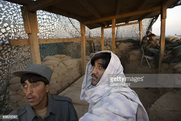 An Afghan National Policeman rests at an observation post in the hills of the Sabari district of Khost Province along the AfghanPakistan border on...