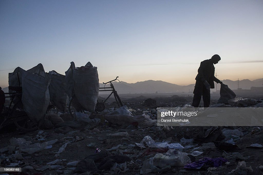 An Afghan Pashtun boy, who said he was forced from the troubled province of Baglan due to threats from the Taliban, scavenges for recyclables at a garbage dump site on November 14, 2012 in Kabul, Afghanistan. Children working at the garbage site in Kabul said they can make up to 90 Afghans (USD $1.75) per day collecting cans and other recyclable materials for sale. If they were to stay and work in their home province, with limited options for employment, and join the Police or Army, the Taliban threatened they would come for them and their families, they said.