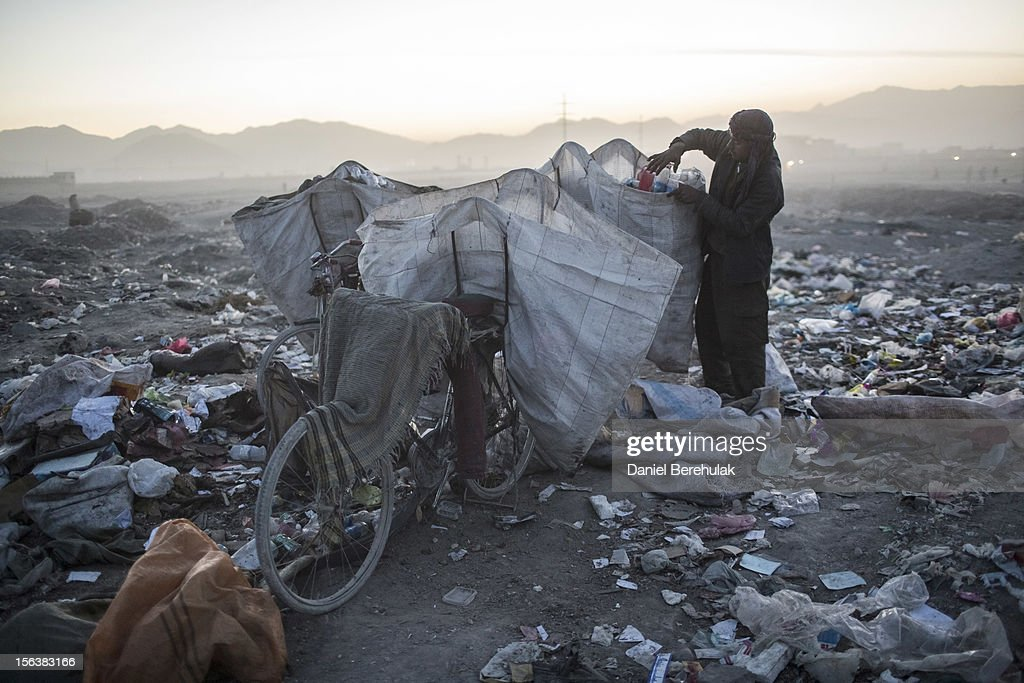 An Afghan Pashtun boy, who said he was forced from the troubled province of Baglan due to threats from the Taliban, scavenge for recyclables at a garbage dump site on November 14, 2012 in Kabul, Afghanistan. Children working at the garbage site in Kabul said they can make up to 90 Afghans (USD $1.75) per day collecting cans and other recyclable materials for sale. If they were to stay and work in their home province, with limited options for employment, and join the Police or Army, the Taliban threatened they would come for them and their families, they said.