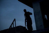 An Afghan police officer stands watch near Kandahar Airfield on June 3 2014 Members of the 1st Battalion 12th Regiment 4th Brigade Combat Team 4th...