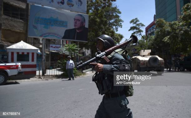 An Afghan policeman holds a rocketpropelled grenade as he arrives near the site of an ongoing attack on the Iraqi embassy in Kabul on July 31 2017 A...