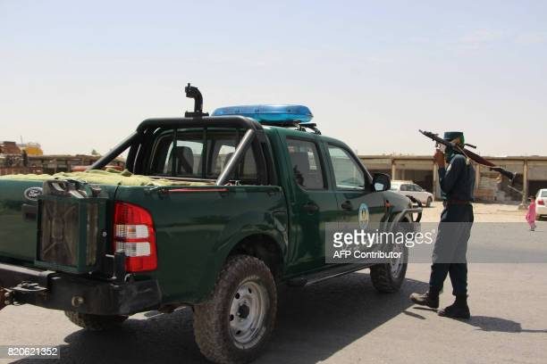An Afghan policeman holds rocketpropelled grenade amid an ongoing battle with Taliban militants in the Gereshk district of Helmand province on July...