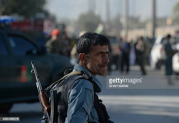 An Afghan policeman keeps watch at the site of a suicide attack in Kabul on October 2 2014 A Taliban suicide attacker killed three people on an...